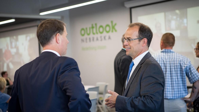 Two men talking during a meeting at Outlook Nebraska.